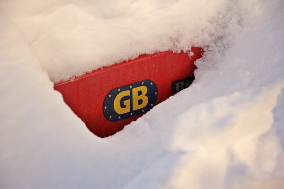 GB sticker on snow-covered car in Val Thorens