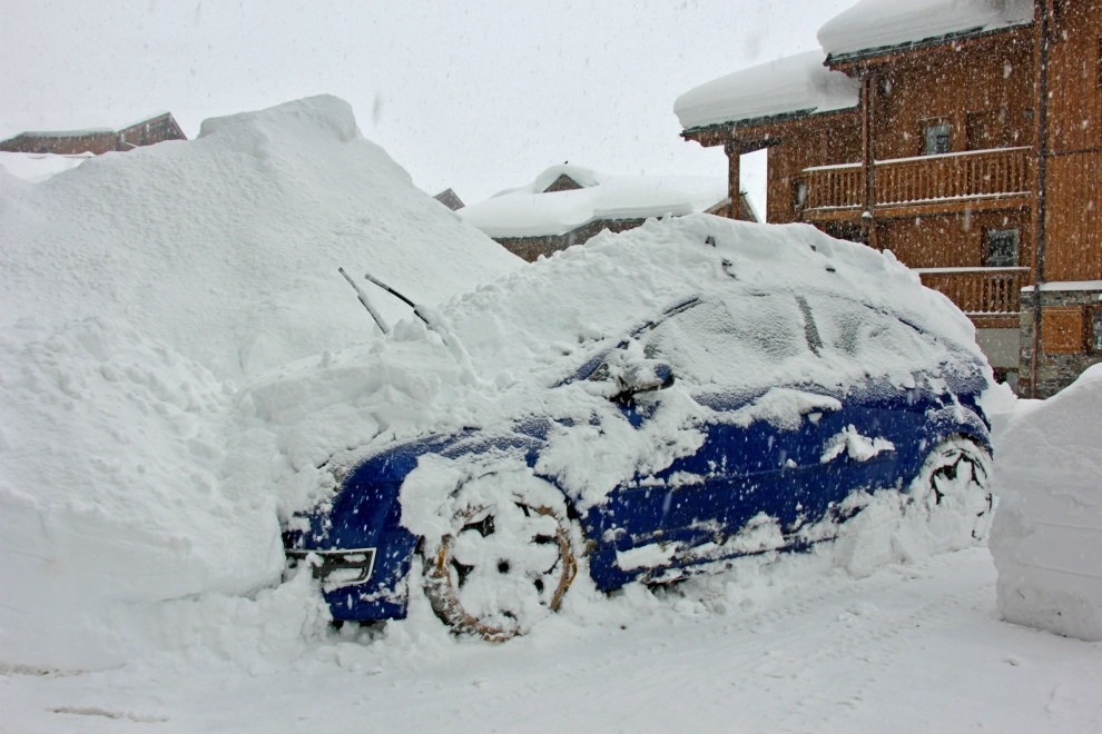 Snow-covered car in Val Thorens